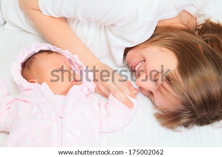 mother enjoying time with newborn daughter, parenting and childcare - stock photo