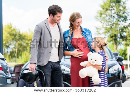Mother, father, and child buying car at dealership, a new family auto - stock photo