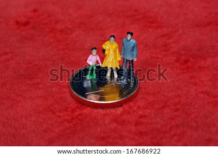 mother father and child on euro coins - stock photo