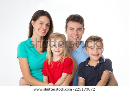 mother, father and children smiling to camera