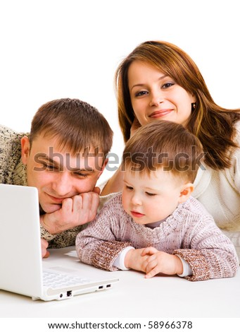 Mother, father and little boy with laptop- computer life - stock photo