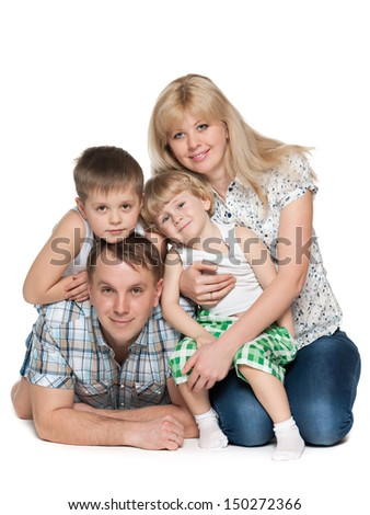 Mother, father and two sons are on the white background - stock photo