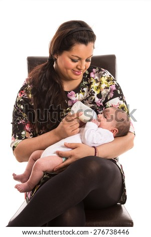 Mother feed her newborn baby girl with milk isolated on white background - stock photo