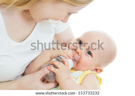 mother feeding baby from bottle - stock photo