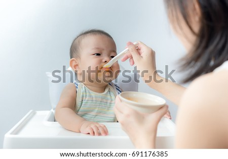 Mother feeding baby with spoon baby boy child sitting eating food on chair at home  sc 1 st  Shutterstock & Mother Feeding Baby Spoon Baby Boy Stock Photo (Edit Now) 691176385 ...