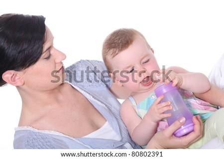 Mother feeding bottle to baby - stock photo
