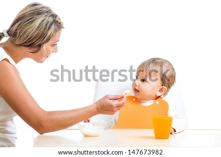 mother feeding her daughter - stock photo