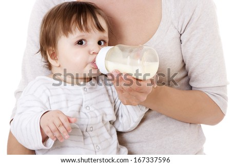 Mother feeding her newborn baby with the bottle. Isolated on white. - stock photo
