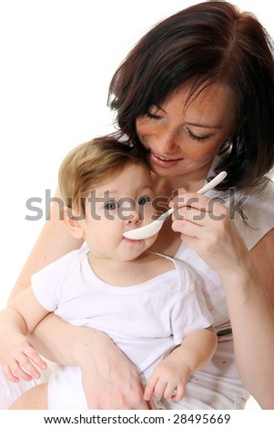Mother feeding hungry baby - stock photo