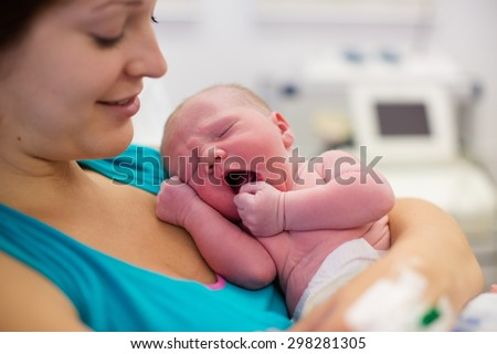mother giving birth baby newborn baby stock photo edit now