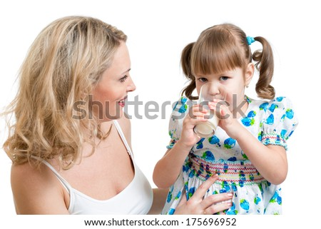 mother giving milk drink to kid - stock photo