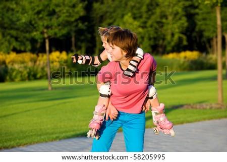 Mother giving toddler daughter a piggyback - stock photo