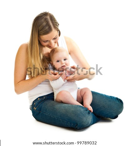 Mother giving vitamins to infant girl isolated on white - stock photo