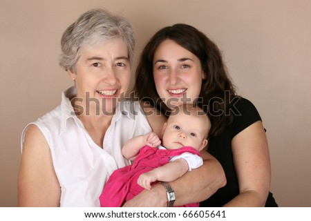 Mother, grandmother and baby girl. Three generations - stock photo
