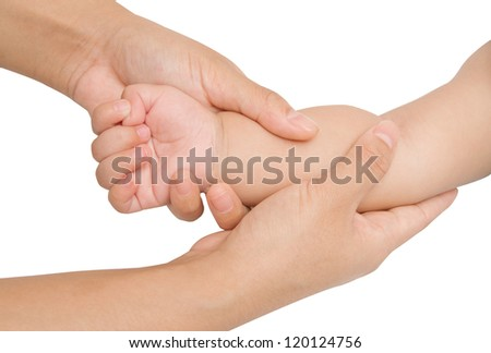 Mother hand massaging forearm of her baby on white background - stock photo