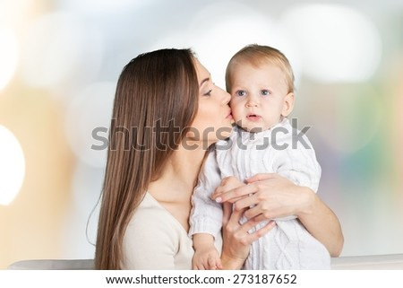 Mother. Happy cheerful family. Mother and baby kissing, laughing and hugging - stock photo