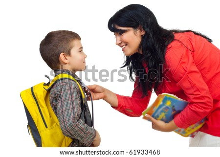 Mother having an conversation with her son before going to school and standing face to face isolated on white background