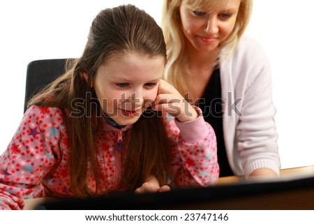 Mother Helping Daughter with school Work - stock photo