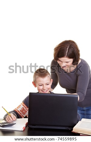 Mother helping his son with his homework and internet research