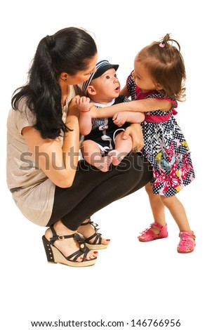 Mother holding baby boy and looking at his sister isolated on white background - stock photo