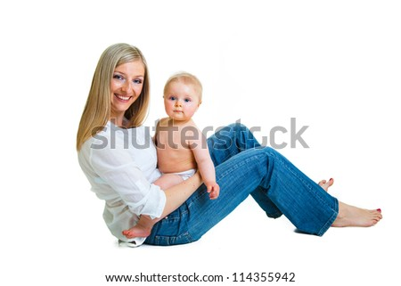 Mother holding cute infant girl isolated on white - stock photo