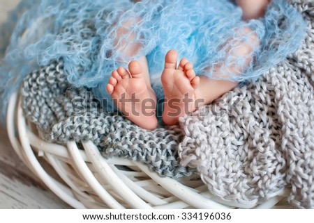 Mother holding head of her newborn son in hands. The baby on hands at mum. Loving mother hand holding cute sleeping newborn baby child - stock photo
