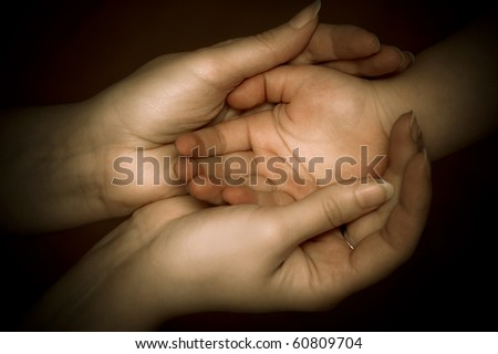 mother holding her child hand - stock photo