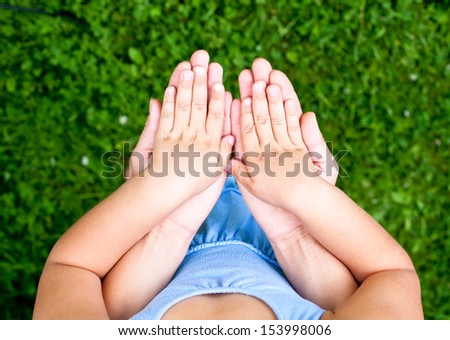 Mother holding her daughter's hands - stock photo