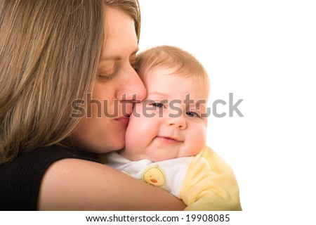 Mother holding her smiling daughter