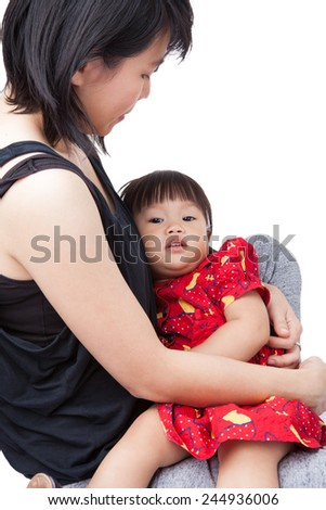 Mother holding little daughter crying. shed tears because of sadness, rage or pain /isolated on white background