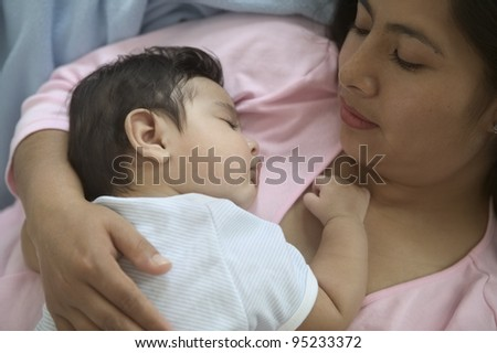 Mother holding sleeping baby