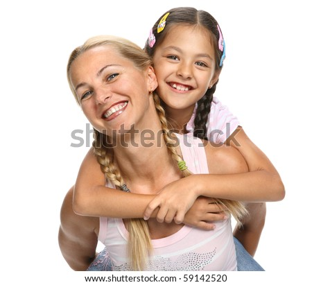 Mother holds a daughter on a back, they cheerfully laugh and embrace on a white background - stock photo