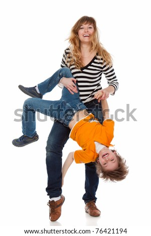 Mother holds head over heels the son. The family plays - stock photo