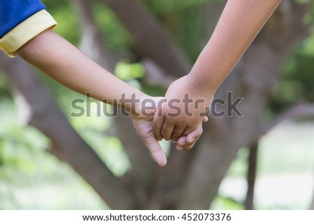 mother holds her child's hand