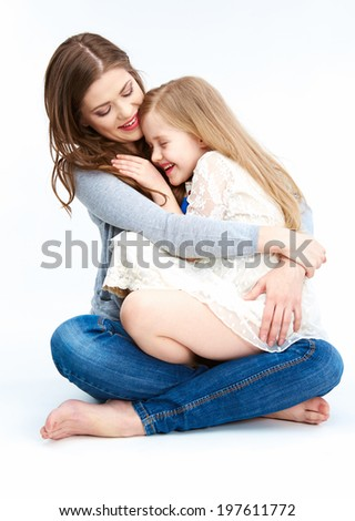 Mother hugging daughter isolated on white background. - stock photo