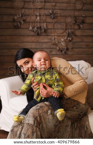 Mother hugging her son, the child poses a funny face. Cute little boy making grimaces, cute, toddler - stock photo