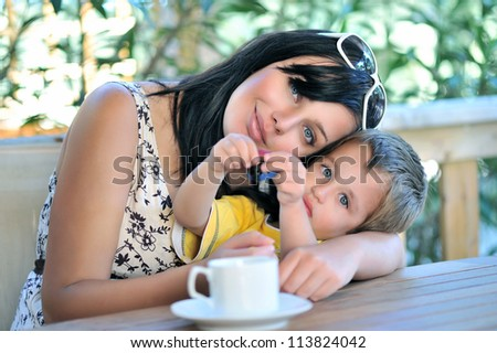 Mother hugging son - stock photo