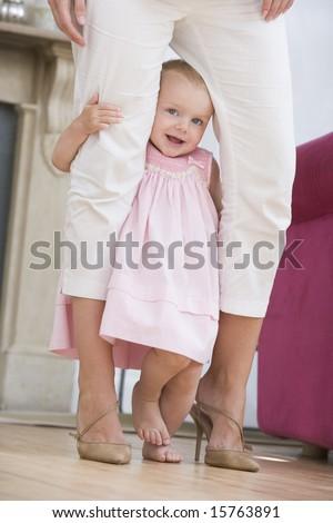Mother in living room with baby - stock photo
