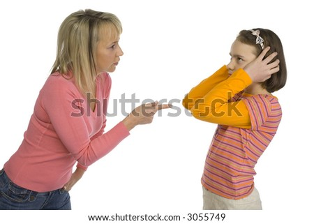 Mother is disciplining her 10-12yo daughter. Girl's stopping her ears. Side view. Isolated on white in studio. - stock photo
