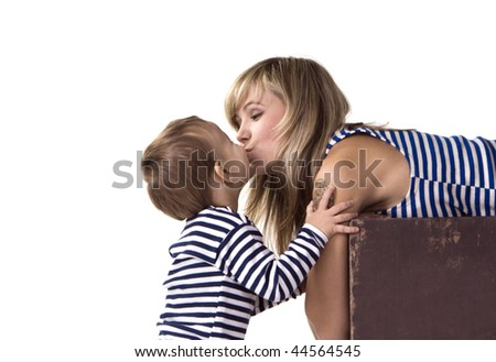 Mother kisses the small son - stock photo