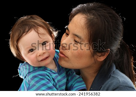 Mother Kissing her Baby Daughter - stock photo