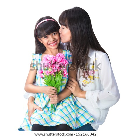 Mother kissing her beautiful daughter, Isolated over white with clipping path - stock photo