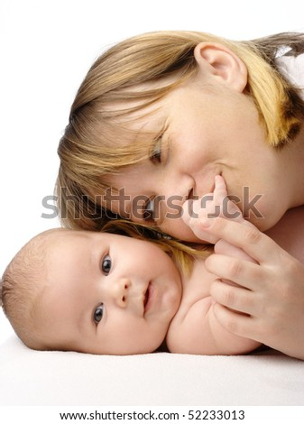 Mother kissing her child's hand, isolated over white