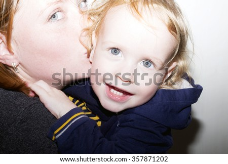 Mother kissing her dear baby - stock photo