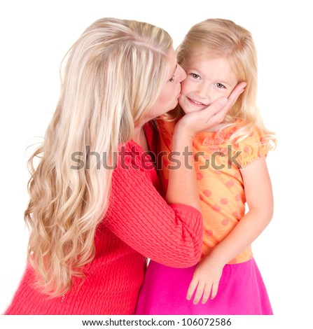 Mother kissing young daughter, isolated on white - stock photo