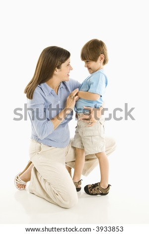 Mother kneeling down with son against white background. - stock photo
