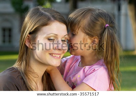 Mother listening her daughter in the park