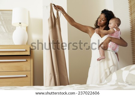 Mother Looking at Dress - stock photo
