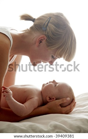 Mother looking at her baby - stock photo