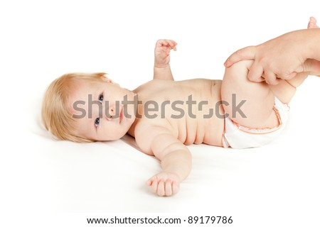 mother massaging her baby girl - stock photo